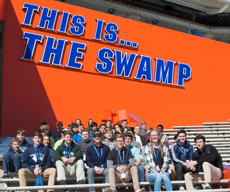 Picture of high school students inside the Ben Hill Griffin stadium during a UF filed trip.