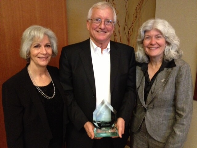 Don McKinney (center), 2012 Gator Engineering Innovation Award recipient, with his wife, Rebecca McKinney (left), and Dean Cammy Abernathy (right) at the 2012 Gator Engineering Innovation Award Ceremony, Palo Alto, CA.