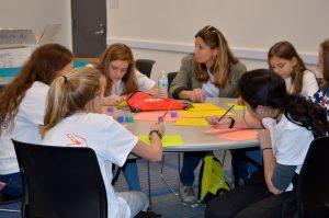 Girls Engaged in Gator Engineering Day participants experience a day in the life of a Gator engineer.