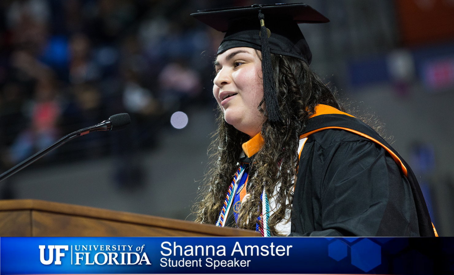 Shanna Amster at podium during graduation.