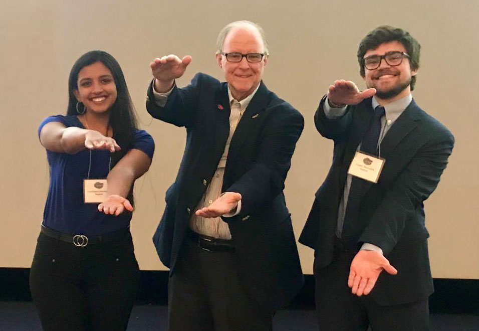 From left: Gouthami Gadamsetty (BS ISE, spring 2021), team faculty coach Bill McElroy, and Gantt Meredith (BS BME, spring 2021) do a Gator chomp.