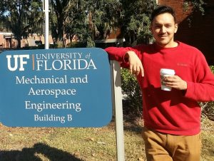 Dr. Jorge Salinas standing next to the Mechanical and Aerospace Engineering Sign